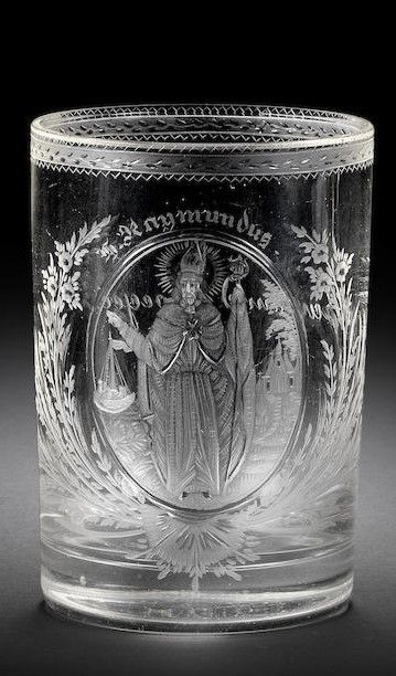 A North Bohemian or Lower Styrian engraved beaker by Hieronymus Hackel, circa 1803-10 The cylindrical form decorated with a portrait of Saint Raymond, holding a staff in his left hand, a merchant ship and a church in the background, all within a plain oval cartouche inscribed S Raymundus above, flanked on both sides by floral sprays, the reverse inscribed Raymund Groeger, the rim with a stylised floral and zigzag border, 11.2cm high
