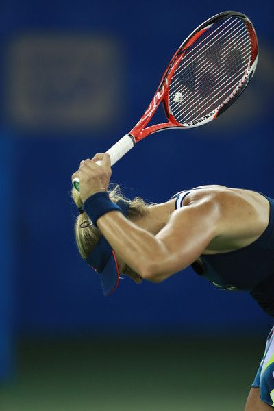 Angelique Kerber Photos Photos - Angelique Kerber of Germany reacts during the fourth round match against Petra Kvitova of Czech Republic on Day 4 of the 2016 Dongfeng Motor Wuhan Open at the Optics Valley International Tennis Center on September 28, 2016 in Wuhan, China. - 2016 Wuhan Open - Day 4