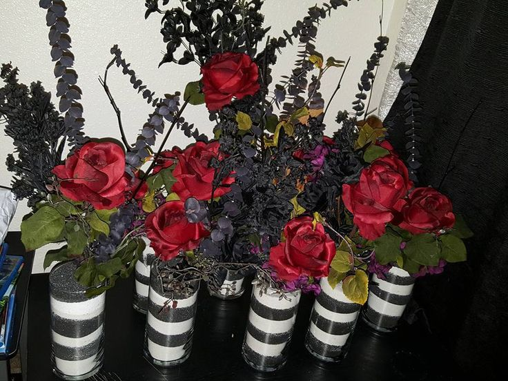 Beautiful black, white & red center pieces used a Beetlejuice wedding we performed.