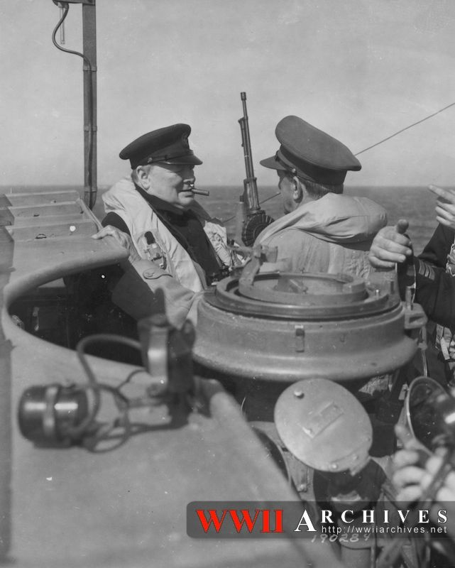 Churchill chats with General Sir Alan Brooke, Chief of the Imperial General Staff on the bridge of a warship which is carrying them to General Sir Bernard Montgomery's temporary headquarters somewhere in France. June 12, 1944.