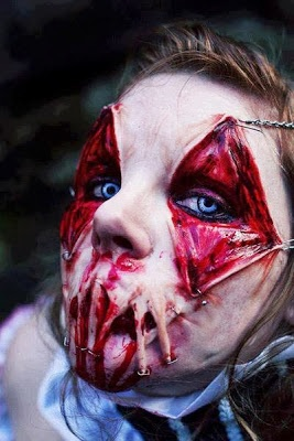 great haunted house makeup job, have to remember, yuck!  Creeps me out and I know it's makeup.