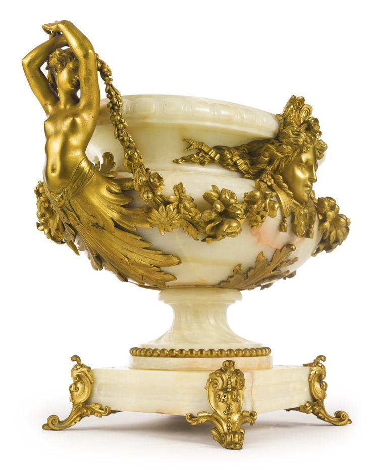 A Louis XVIstyle gilt bronze-mounted onyx centerpiece. France, late 19th century.