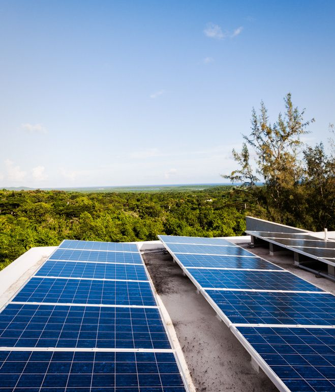 """On the roof, Casa Solaris has 24 solar panels, which feed to 12 batteries in what the architect calls """"the engine room,"""" plus two 50-gallon, solar hot water heaters, which feed to the sinks and outdoor showers. Photo by Michael Grimm.   Photo by Michael Grimm ."""