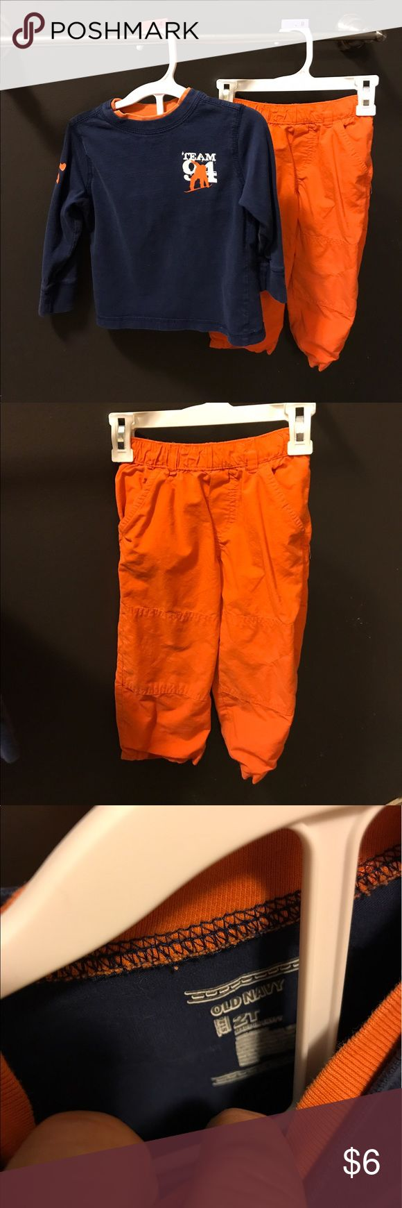 Old Navy Blue Tee & Circo Orange Lined Pants sz 2T Bundle of a boys long sleeves tee and lined pants size 2T. Old Navy navy blue tee with orange trim has a snowboarding theme. Front a figure and team 94. Right sleeve King of the Mountain. Back 103 with figure. Made in Egypt of 100% cotton. Circo orange pants have an elastic waist. Lining has pills in them from wash and wear. There are 2 pockets and knees look like they have patches on them. Made in Dominican Republic. Shell: 70% cotton…