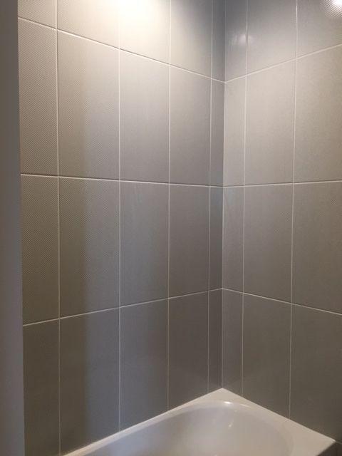 Sleek Gray Vertical Stacked Wall Tile Daltile Showscape 12x24 Wall Tile Shower Design B Bathtub Tile Patterned Bathroom Tiles Bathroom Shower Walls