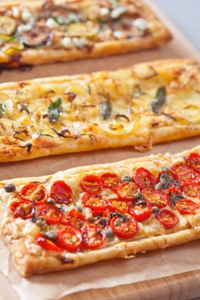 Puff pastry vegetable tarts: 1 (17-ounce) package frozen puff pastry, thawed; 2 cups shredded vegan cheese; 1 pint grape tomatoes, each halved; 1 large yellow bell pepper, seeded, sliced; Handful of chopped fresh herbs of your choice.