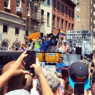 """Other cast members took a ride on the Litchfield Correctional Facility float, decked out with laundry baskets, balloon suds, and a giant washing machine. 
