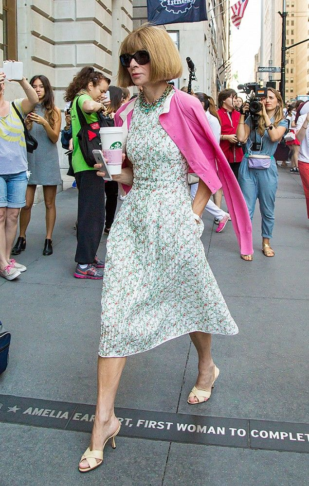 Anna Wintour drapes a pink cardigan over a floral dress. // #Celebrity