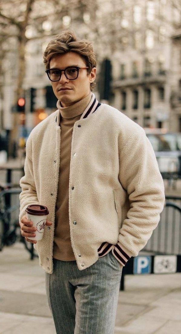 cb9edb50c63 Fall combo inspiration with a tan turtleneck sweater shearling varsity  jacket gray striped pants. model unknown.  fallfashion  falloutfits   menswear ...