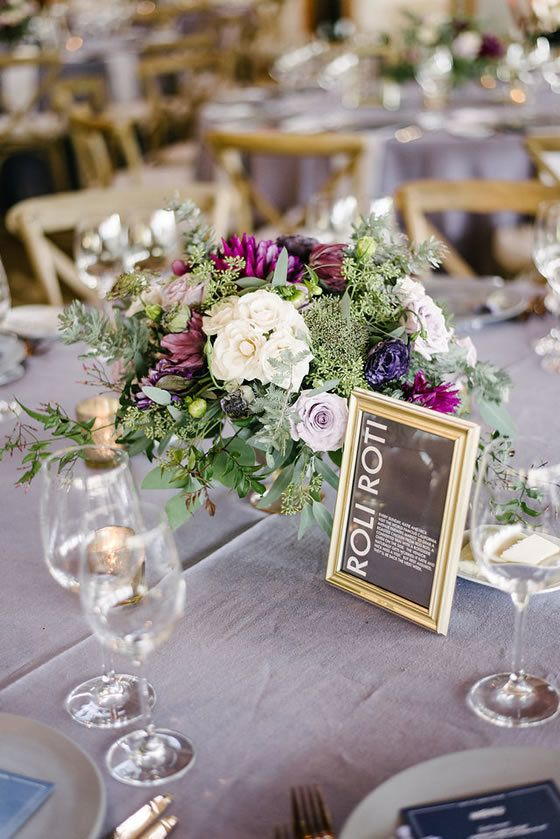 Floral centerpieces crafted of lavender and purple blooms and silvery-green foliage. Carmel Valley Ranch / Melanie Duerkopp Photography