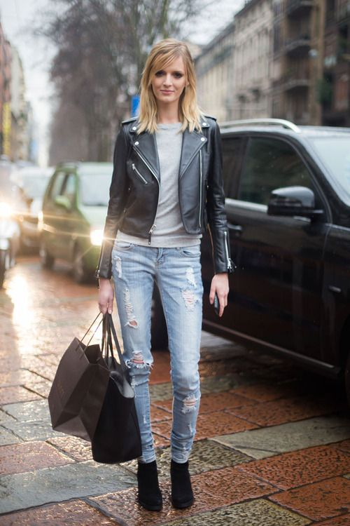 Shop this look for $169:  http://lookastic.com/women/looks/biker-jacket-and-crew-neck-sweater-and-skinny-jeans-and-tote-bag-and-ankle-boots/2307  — Black Leather Biker Jacket  — Grey Crew-neck Sweater  — Light Blue Ripped Skinny Jeans  — Black Leather Tote Bag  — Black Suede Ankle Boots