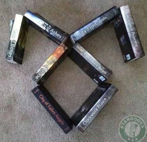 cassandra clare's books. angelic power rune ❤️ this is soo cool. i want to do this with my books (: