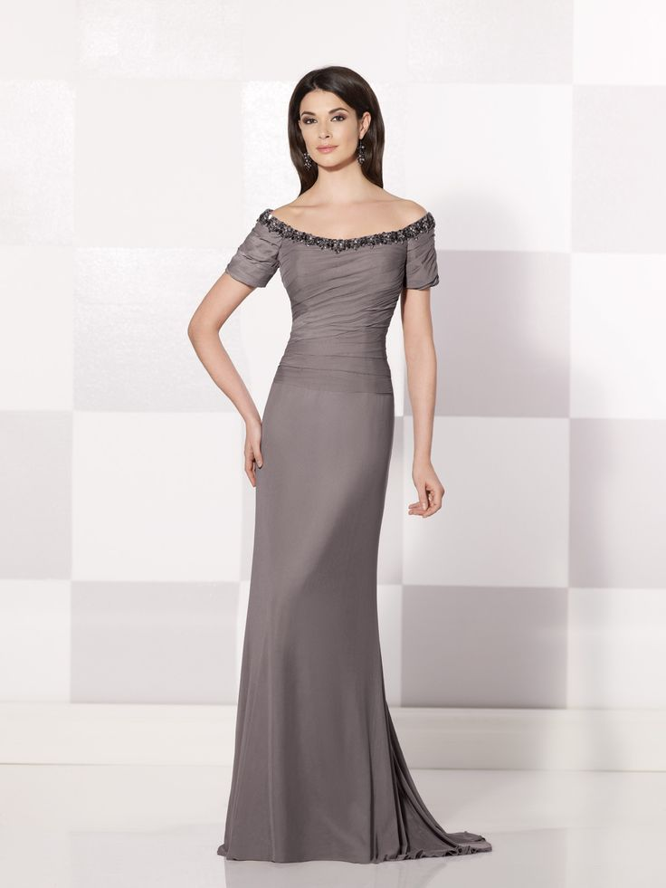 Stretch mesh A-line dress with front and back hand-beaded off-the-shoulder necklines, short sleeves, ruched bodice, sweep train, suitable as a mother of the bride dress or mother of the groom dress. Matching shawl included. Embellish by David Tutera earring style Abby Vine sold separately. Sizes: 4 – 20, 16W – 26W Colors: Pewter, Purple, Poppy, …