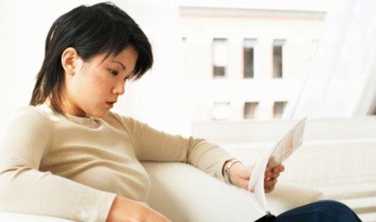 A woman comparing Home Insurances.