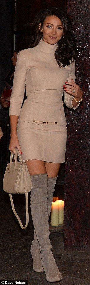 These boots are made for walking: Michelle's over-the-knee suede boots showed off her slim legs to maximum effect