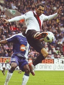 Wigan Ath 0 Man City 2 in Sept 2010 at DW Stadium. Carlos Tevez jumps up to control the ball #Prem
