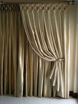 Beautiful header on these curtains- large smocking.  Maybe in Bedroom??  You'd need totally new fabric, I think--the twill you have may not work.