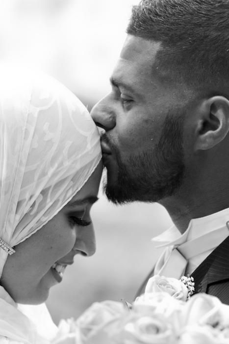 muslim bride in her hijab and her groom