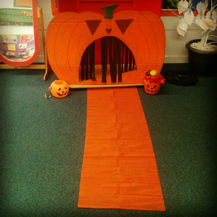 Hungry pumpkin game i made for nursery Halloween party using a large sheet of cardboard, poster paints and crepe paper. I got the idea from http://supersimplelearning.com/halloween/party-ideas/