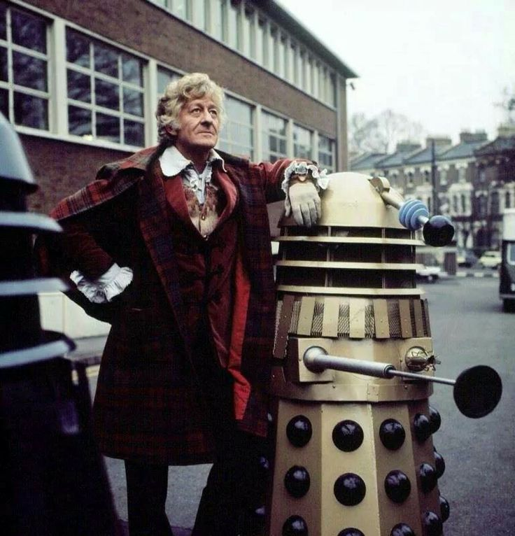 The Third Doctor posing with a Dalek.