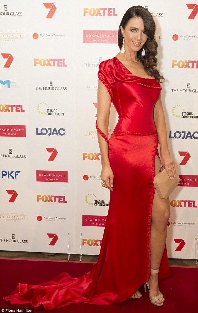 Leggy lady: Former Bachelor 'villain' Emily Simms donned an elegant red frock that feature...