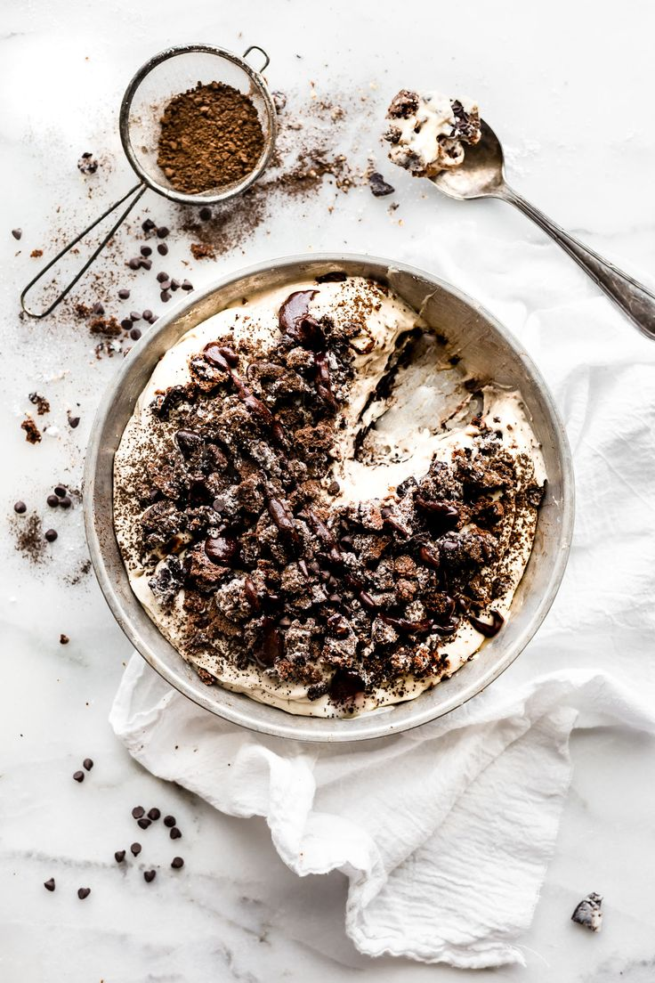 """A vegan friendly no bake dirt pie just got a """"Healthy-ish"""" makeover! This EASY no bake dessert made with gluten free and dairy free """"Oreo"""" type cookies, coconut cream, dates, dark chocolate, and more. Plus it has the perfect 3 ingredient no bake dark chocolate crust to go with it. Healthier than the classic, but just as tasty!"""