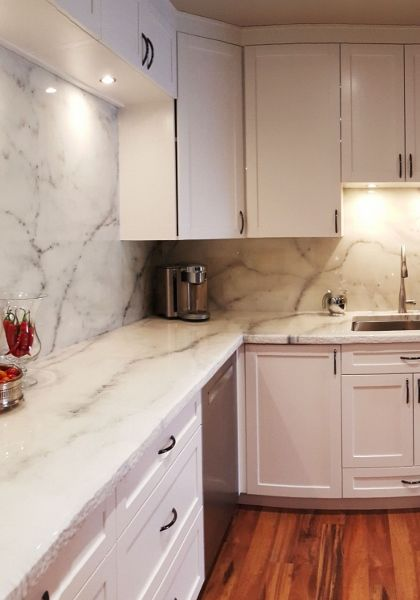 white-marble-kitchen- epoxy countertops!! Mimics granite or marble, can go right over laminate or mdf, etc., up to 500 degrees, antibacterial (& food safe).