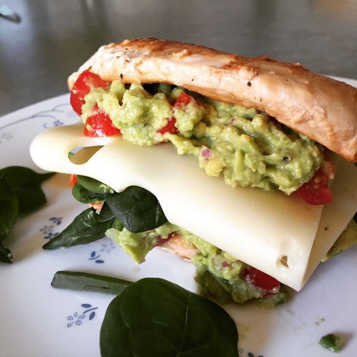 my 'chicken sandwich'. i'm having a small, butterflied, pan cooked chicken breast filled with homemade guacamole, spinach and swiss cheese, for lunch. couldn't pick this bad boy up so went at it with a knife and fork. for the guac i used a whole avo, mashed up with fresh lime juice, cayenne pepper, garlic powder, salt and pepper, then stirred in some red onion and grape tomatoes for colour and a kick! xo