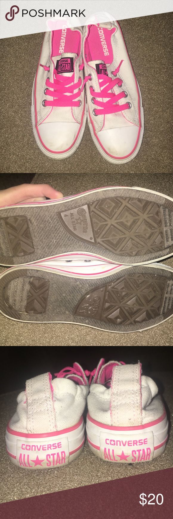 Converse Slip Ons White And Pink Converse slip on shoes. Very comfy. like new condition and will be cleaned before shipment. Size 4 Converse Shoes