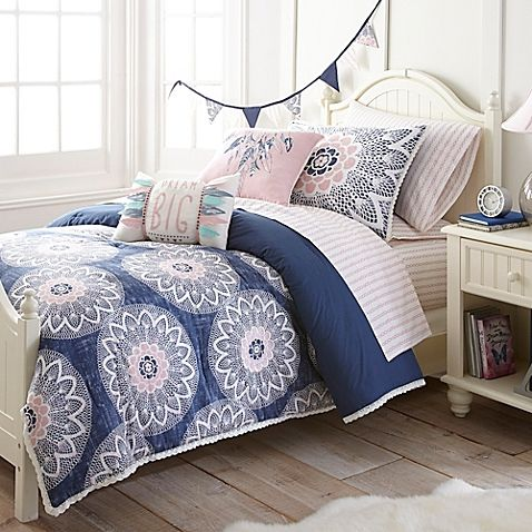 Breathe new life into your bedroom with the whimsical Frank and Lulu Dream Catcher Comforter Set. Decked out in an oversized floral dot print, the lively navy, white and pink bedding is an enchanting addition to any room's décor.