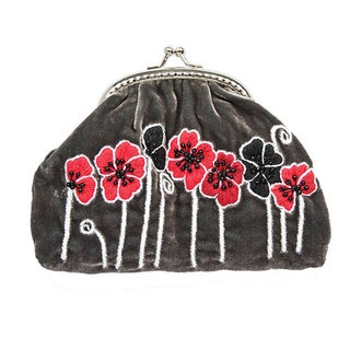 This enchanting Poppy coin purse is contemporary and fun. The bold, hand embroidered poppies are set out against a luxurious velvet outer with matching satin lining. The darling vintage style clip close makes this a classic design.