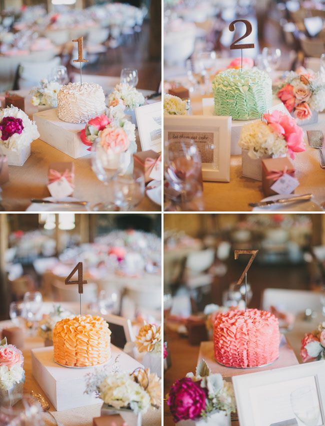 Mini cakes with table numbers for the centerpieces! So fun!