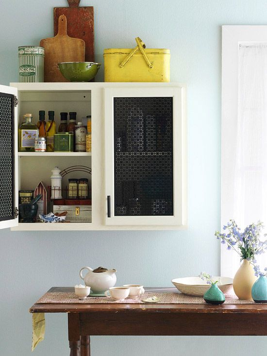 Patterned sheet metal like this radiator cover gives a fresh yet vintage vibe to a cabinet door.