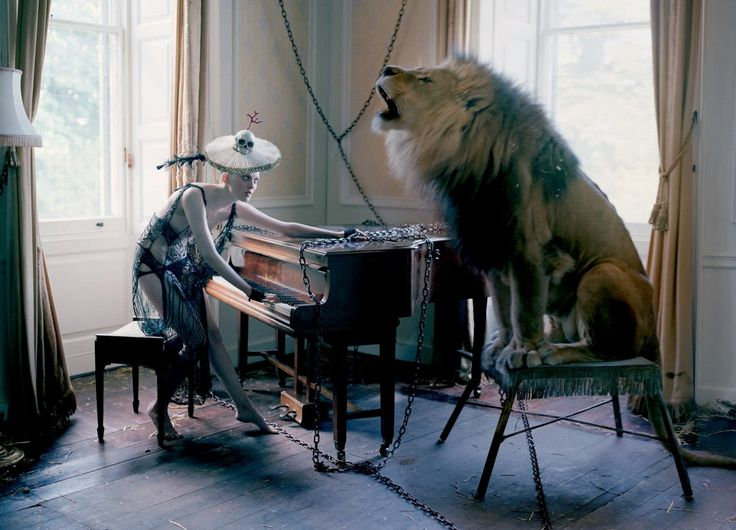 Model Karen Elson accompanied by a grand piano and a lion, photographed by Tim Walker for Love Magazine, 10 Fall/Winter 2013/2014