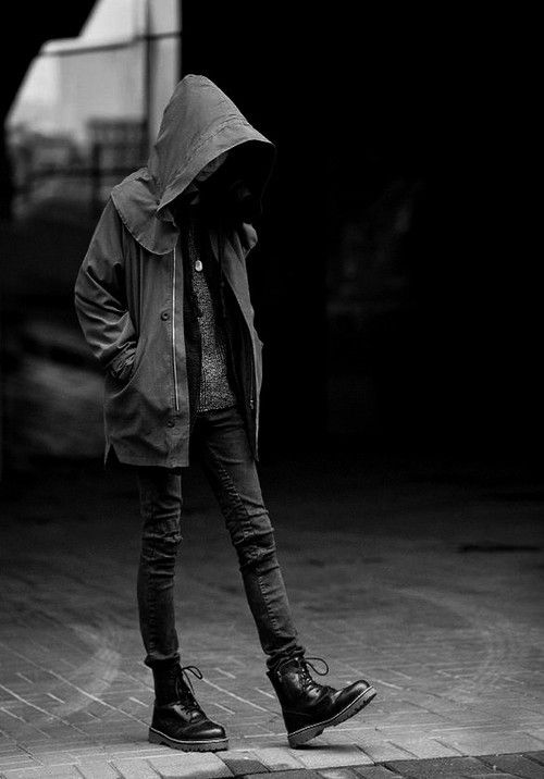 A girl, dressed in all black, has been silently following your character for the past half hour. How does your character react to this?