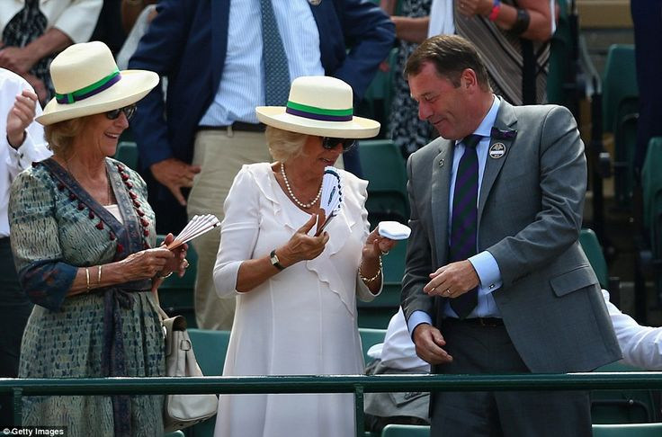 The Duchess of Cornwall wrinkled her nose as she held the sweatband thrown by Andy Murray, despite Mr Brook's evident amusement