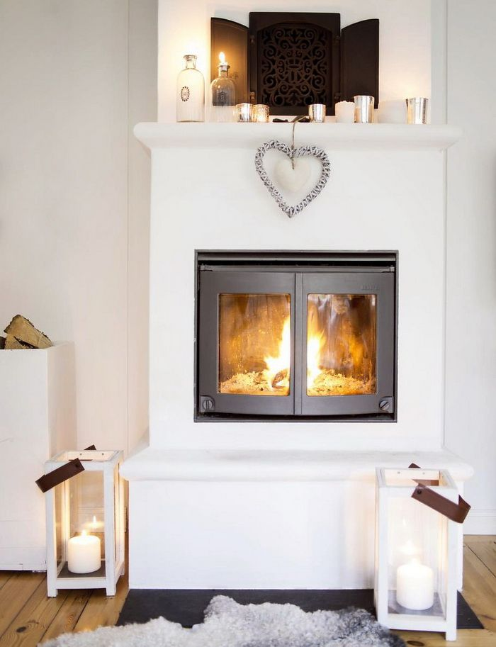 ♡ Wow! Amazing charcoal log burner within the white chimney breast. How gorgeous!