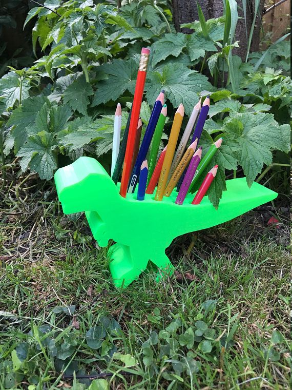 Check out these totally ROAR-SOME dinosaur, T-Rex pen pot. Just over 20 hours of printing and you get this fun desk accessory for all! Can be personalised on the foot if preferred - just let us know upon ordering. Theyre approx. 25cm wide (head to tail); 12cm tall, and 6cm thick. *Pencils