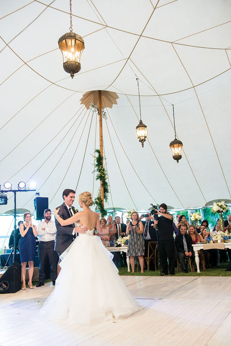 Decorative lanterns hung from the tent ceiling created a romantic ambiance for the couple's first dance as husband and wife.  Lakeside Soire - Orlando Magazine - June 2016 - Orlando, FL