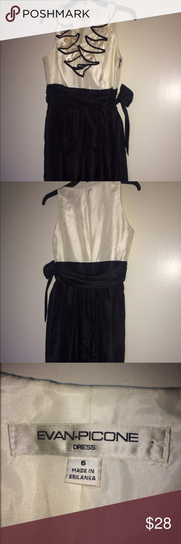Beautiful Special Occasion Dress! Beautiful black and white special occasion dress! Great condition! Knee length, zipper up side and ties at side. Love the ruffles! Size 6 Evan Picone Dresses