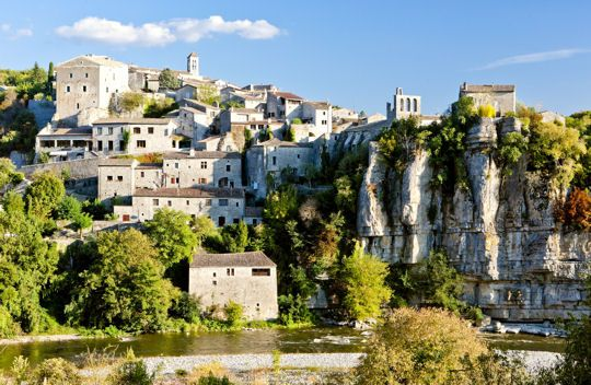 """Balazuc, Ardèche, labeled among the """"most beautiful villages in France"""". Built on a cliff overlooking the River Ardèche, it has kept many traces of its medieval past including the Romanesque church, its castle, its archways and winding streets."""