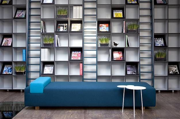 Creative ideas for built-in wooden wall shelves or contemporary modular shelving help decorate empty walls in elegant and impressive style