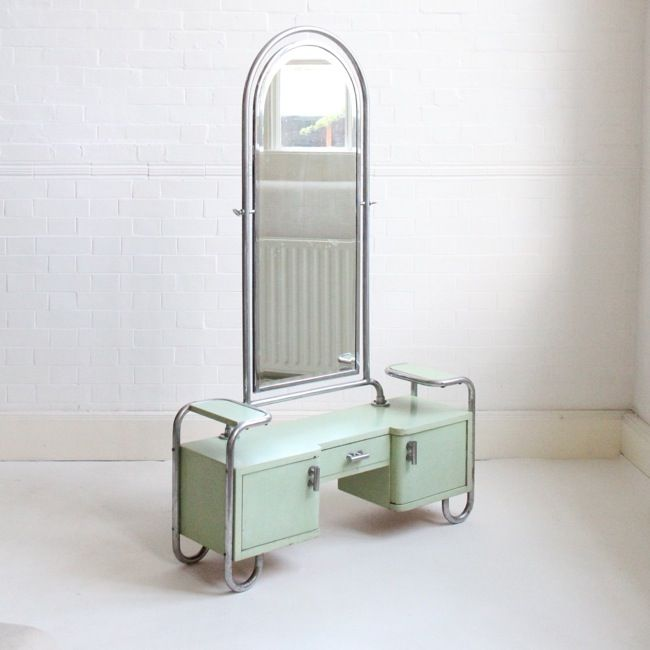A stunning mint green dressing table with mirror, attributed to Thonet C1930  A striking, rare and unique piece from the Bauhaus era. The frame is tubular steel and the table is wooden with original paint.  In good original condition with some patches of wear and cracks to the paintwork. Has pleasing patination to the mirror.