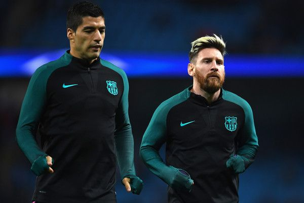 Luis Suarez of Barcelona (L) and Lionel Messi of Barcelona(R) warm up prior to kick off during the UEFA Champions League Group C match between Manchester City FC and FC Barcelona at Etihad Stadium on November 1, 2016 in Manchester, England.