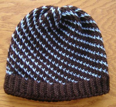 loom knit spiral striped hat instructions. pattern: 2 brown, 1 blue, 2 brown, 1 blue, etc.