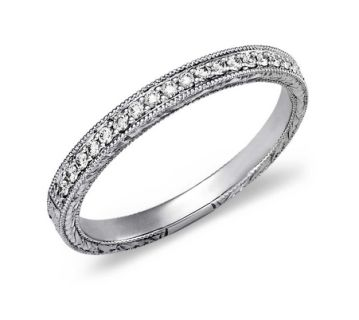 14ct White Gold Vintage Style Wedding Ring 0.20ct £975.00 Inspired by vintage design, this beautiful diamond ring is made in 14ct white gold. This ring features millgrained edges that frame delicate engraving set with 19 micropavé round diamonds with a carat weight of 0.20ct. Highly finished and rhodium plated for extra sparkle.  The ring has a thickness of 1.75mm and a width of 2.35mm. Supplied with luxury packaging.