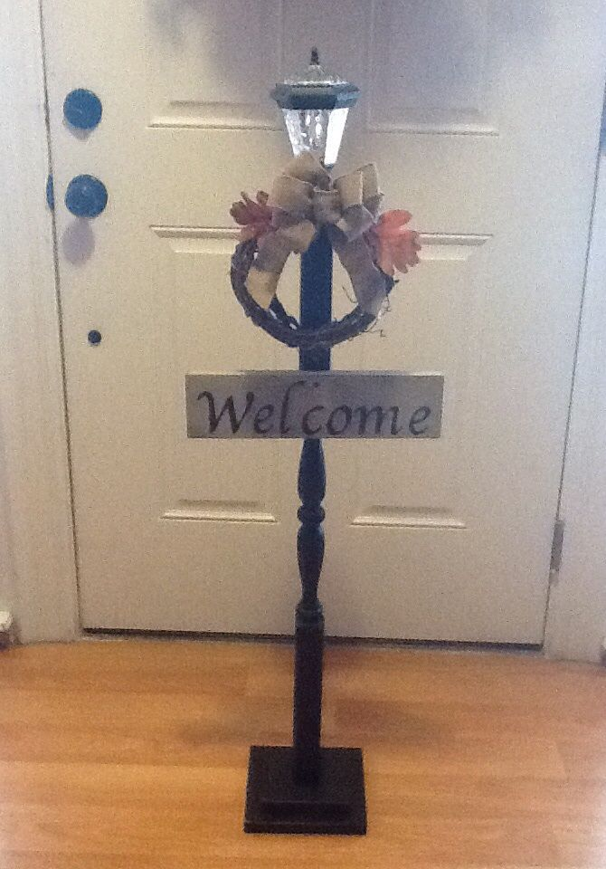 I made this light post with interchangeable seasonal wreaths using a wooden stair spindle. Very simple.