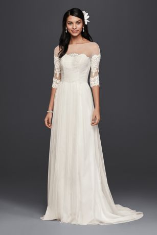 """Carefully placed lace gives the illusion of an off-the-shoulder neckline on this lace wedding dress. A soft tulle skirt and sheer sleeves make it effortless.  Galina, exclusively at David's Bridal  4"""" extra length dress  Polyester  Sweep train  Button-back closure; fully lined  Dry clean  Imported  Also available in Regular Plus Size Petite and Plus Size Extra Length"""
