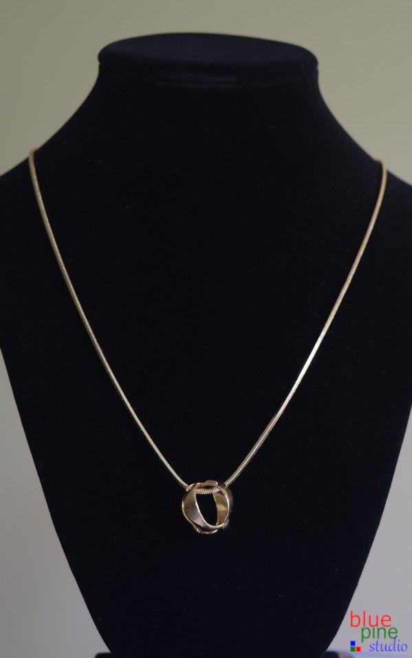 Pendant necklace in precious and semi-precious metals, a floral design by Blue Pine Studio