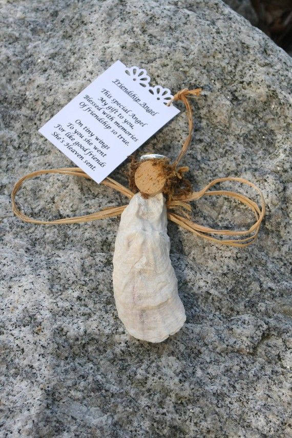 Oyster shell angel - even cuter with Spanish moss hair